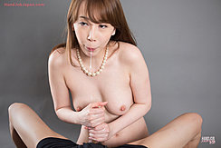 Giving Handjob With Both Hands Pearl Necklace
