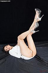 Raising Her Legs In High Heels Panties Exposed