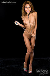 Standing Naked In High Heels Tanned Body Small Breasts Wearing Chain Around Her Neck