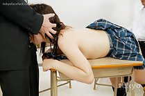 Aina Yuka sucking cock benind over school desk in uniform