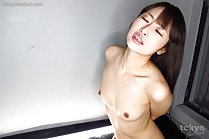 Aoki Mana on her knees sucking cock with arms tied