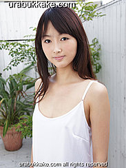 Long Hair Straggling Over Her Shoulder Wearing White Slip